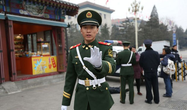 China detains 9 for spreading rumours on military