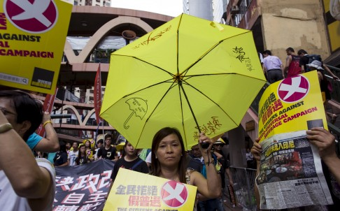Hong Kong protesters march against 'false democracy'