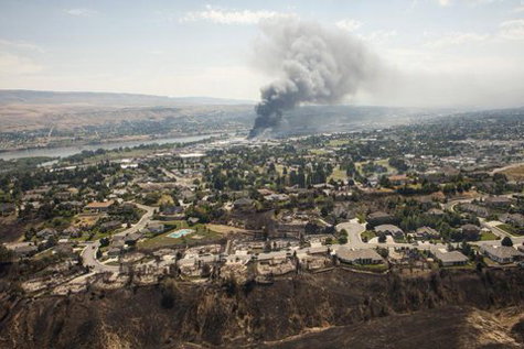 Washington state wildfire destroys at least 23 homes