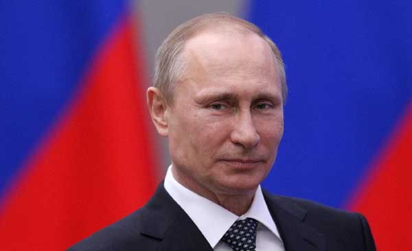 Putin in Crimea, warns no ethnic group will have special status