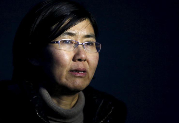 China accuses Uyghur academics' lawyer of inciting 'disruption'
