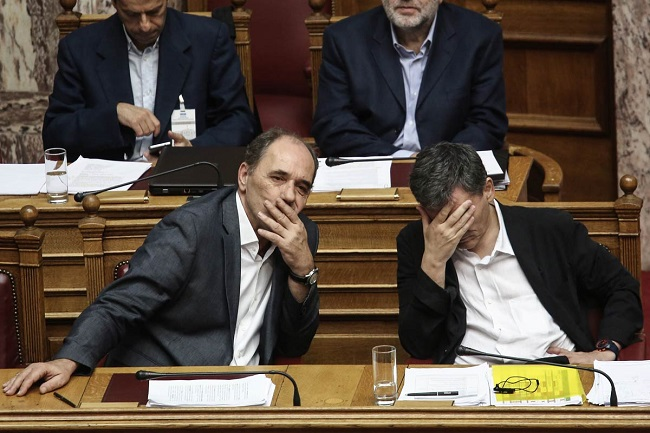 Greek parliament approves bailout after all-night debate