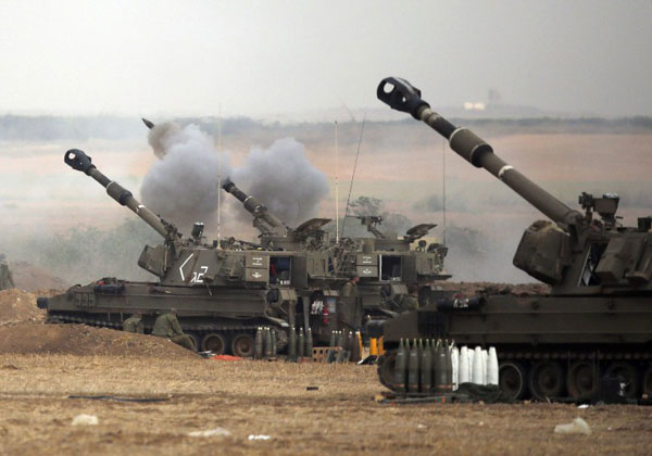 Israel responds to Syria rocket fire with artillery, air strikes