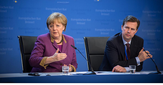 Merkel slams 'vile' violent protests against refugees