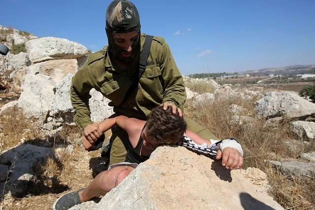 Israel arrests parents of boy beaten at Friday rally