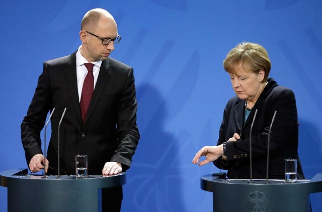 Merkel urges Kyiv to press on with painful reforms