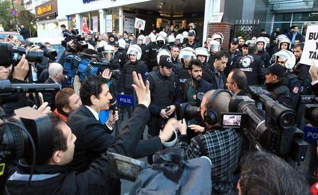 Police, protesters clash at 'parallel state'-linked company HQ