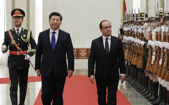 France, China agree on climate change checks