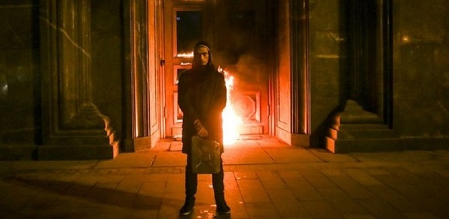Russian artist held for torching security service HQ