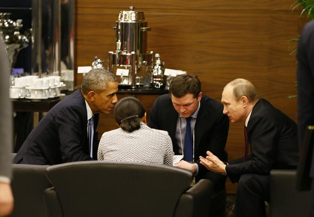 Obama, Putin hold coffee-table talks at G20
