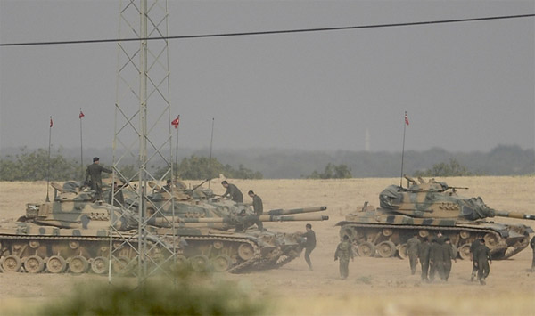 Turkish army, Kurd-backed forces clash in north Syria