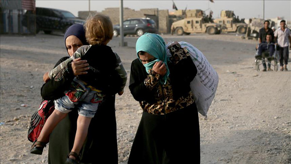 Hundreds flee ISIL rocket attacks in Iraq's E. Mosul