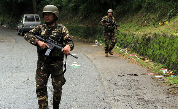 Philippine troops seize $1.6M from besieged terror base