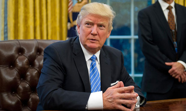 Trump defends restricted entry for Muslims