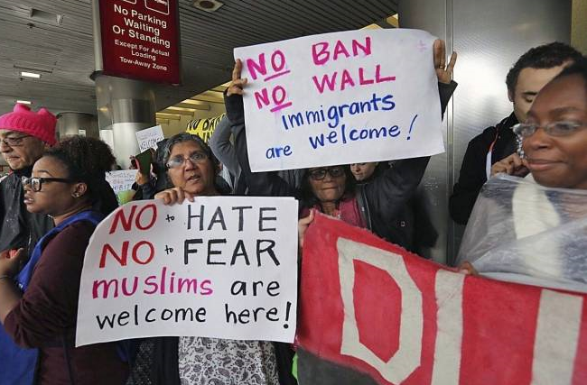 Canadians rally at US embassies to protest travel ban