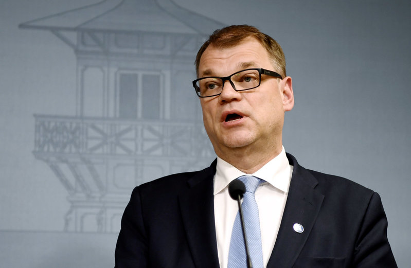 Finnish PM seeks new coalition after ousting populists
