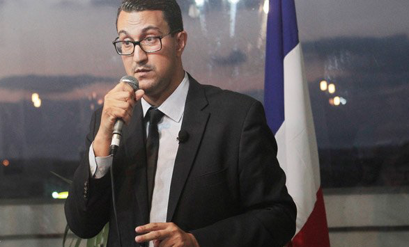 French MP in Macron's party charged over violent clash