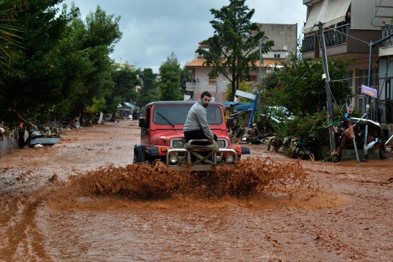 Athenians in shock after deadly flooding