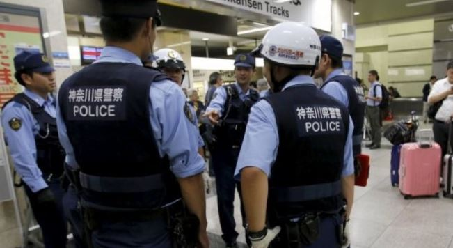Japan minister sorry as 6,000 police hunt fugitive thief