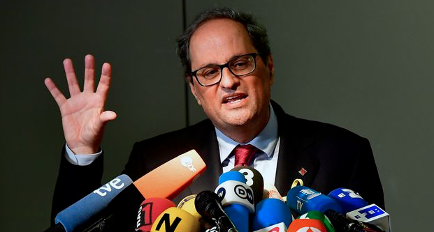 New Catalan leader shuns constitution as sworn in