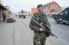Plan cuts Kosovo from Serbia, with strings, UN sources say