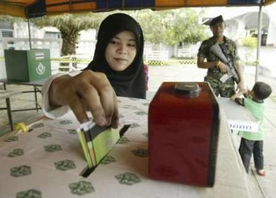Thais vote for Senate still under army's sway