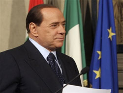 Italy's Berlusconi to visit Gaddafi: Minister
