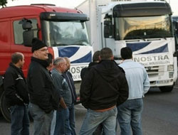 French truckers block roads in fuel protest