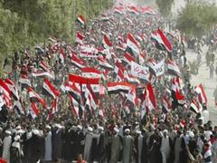Iraqis Mark Baghdad's Fall in anti-US protest