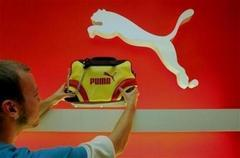 French PPR buys stake in Puma