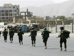 NATO hands Kabul security to Afghan forces