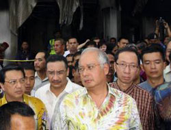 Malaysia's PM calls for calm after church attacks