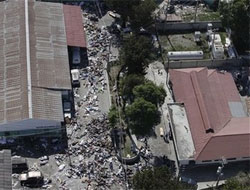 Scenes from hell as dead pile up at Haiti hospital