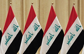 Iraq's central bank devalues national currency