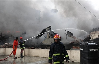 Death toll in Bangladesh's factory fire rises to 52, at least 35 injured