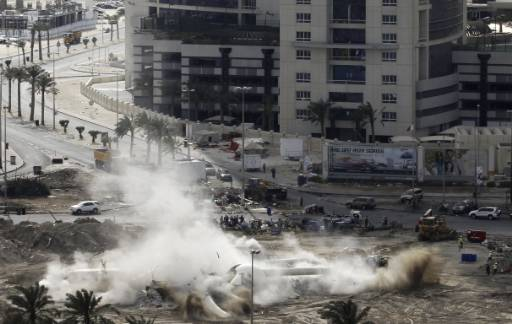 Bahrain downs symbol of protests