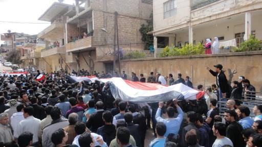 Syria buries scores of dead; more protests due