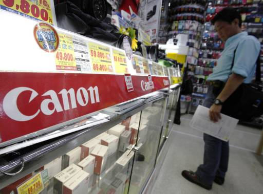 Canon profit hit by slower sales in emerging economies