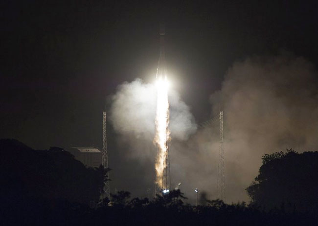 Russian-U.S. crew blasts off for space