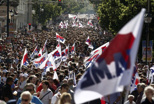 Greek public sector workers strike, thousands rally