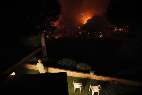 Wildfires rage in California, hundreds forced to flee