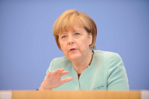 Merkel 'uncertain of success' ahead of talks in Minsk