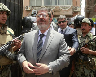 Morsi rejects questions about his lawyer