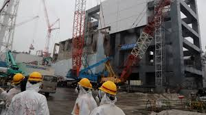 Fukushima says workers dusted with radioactive particles