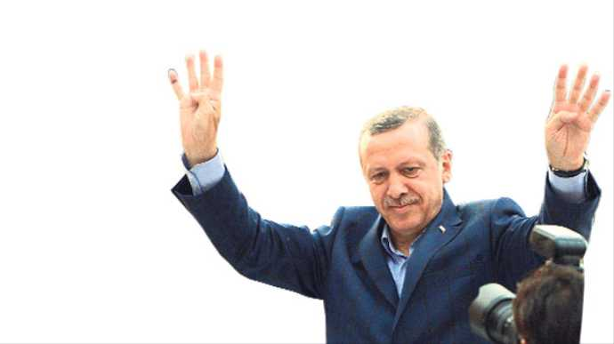 Turkish PM greets crowd with 'Rabaa sign'