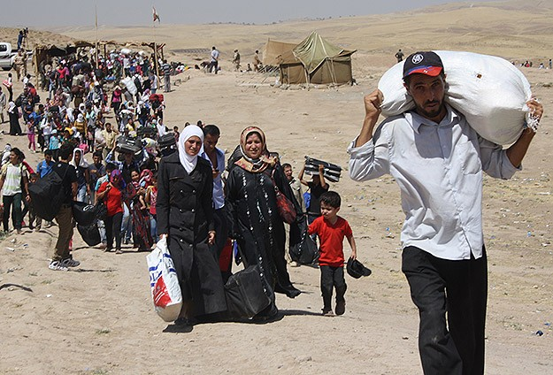 HRW: Jordan barring entry to Palestinians fleeing Syria