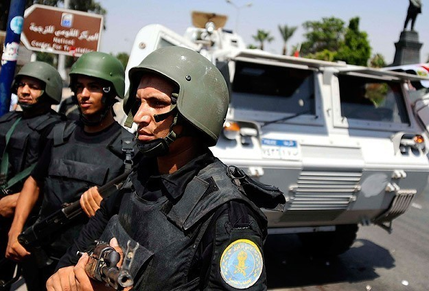 Two Egyptian police shot dead outside Coptic Church
