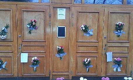 Flowers placed at entrance of swastika-vandalized mosque in Sweden