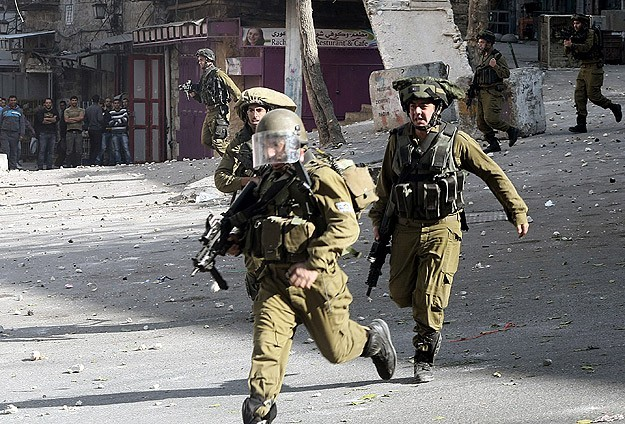 Clashes erupt in Hebron after Israel kills suspects