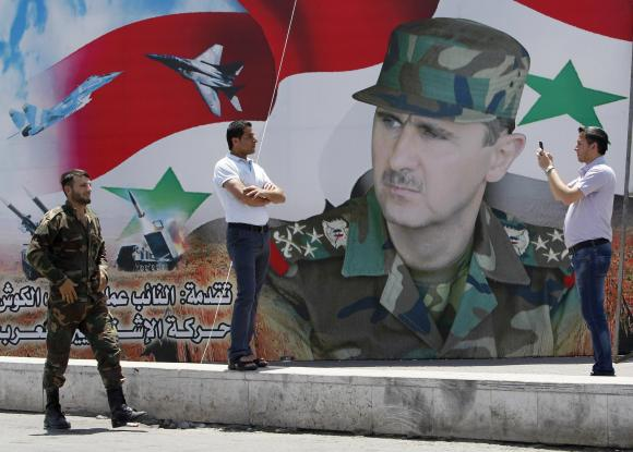 Assad contemplates retaking the whole country after election